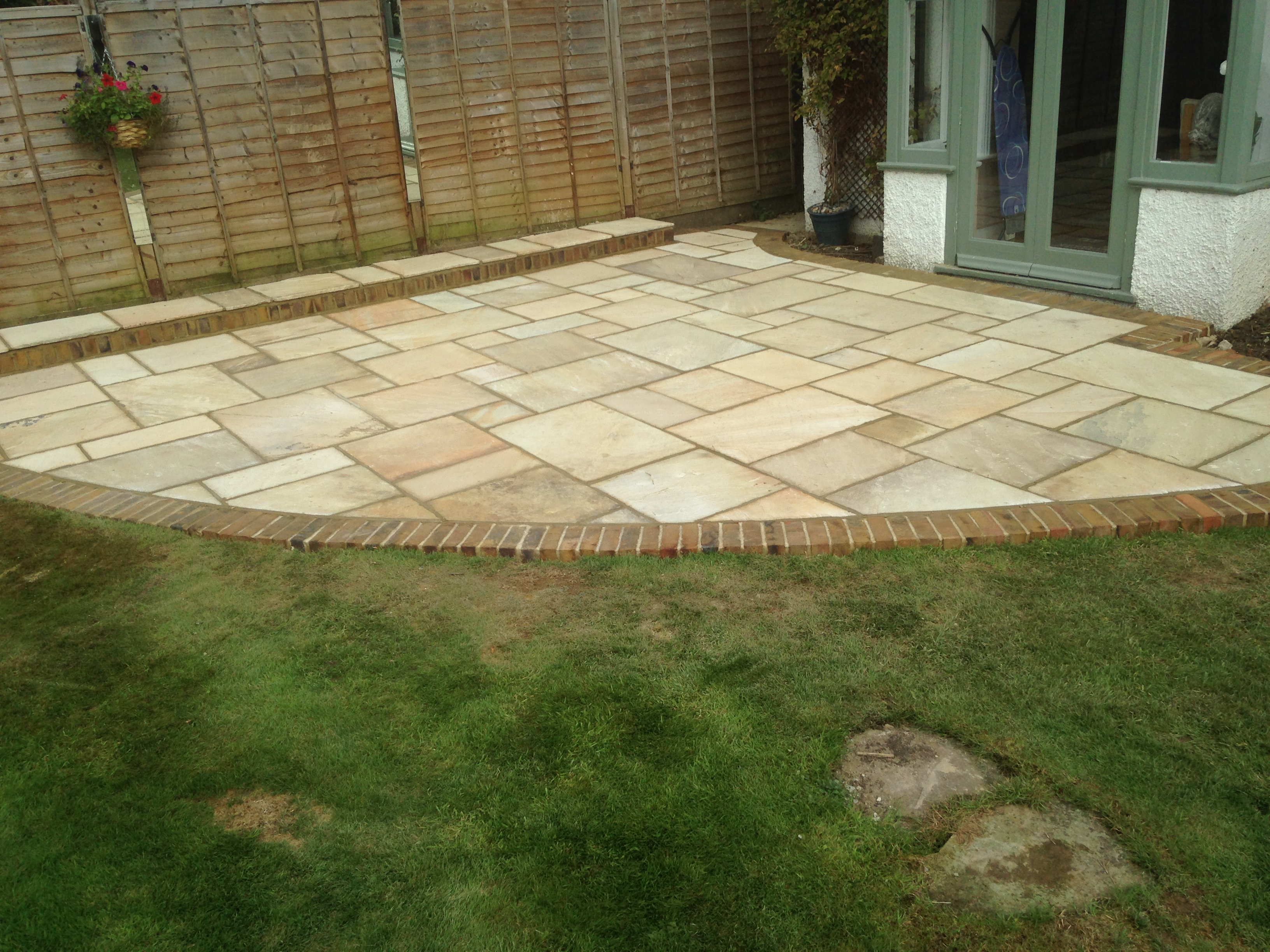 The Patio Makes This Small Garden A Larger Feel By Creating A Good Use Of  The Available Space. The Sandstone Patio With Brick Edging Is Very  Complimentary ...